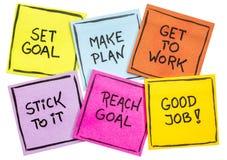 Ajuste e alcance o conceito do objetivo em um grupo de notas foto de stock royalty free
