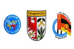 Ajuste emblemas retros do vintage da república Democrática alemão RDA de Deutschland isolada em um fundo branco Fotos de Stock Royalty Free