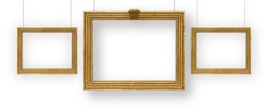 Ajuste molduras para retrato douradas Fotos de Stock Royalty Free