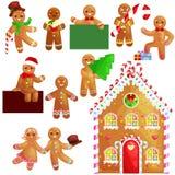 Ajuste o homem e a menina de pão-de-espécie das cookies do Natal perto da casa doce decorada com dança de crosta de gelo e que te Fotografia de Stock