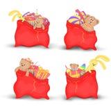 Ajuste sacos vermelhos do Natal dos presentes e dos brinquedos O Natal bonito ensaca Santa Claus Isolado em um fundo branco brinq Fotografia de Stock Royalty Free