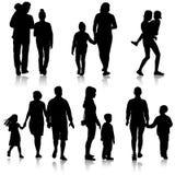 Ajuste a silhueta da família feliz em um fundo branco Imagem de Stock Royalty Free