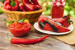 Ajvar in bowl with red paprika. On the table Stock Photography