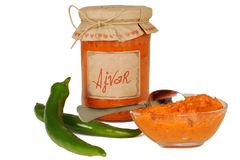 Ajvar - delicious dish of red and green peppers, onions, garlic, eggplant. Ajvar in jar. royalty free stock photos