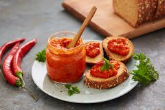 Free Ajvar Pepper Mousse In A Jar And On A Slices Of Bread Stock Photo - 108539050