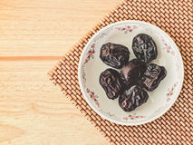 Ajwa Dates fruit on wooden table Royalty Free Stock Photography