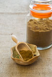 Ajwain powder. In bowl on textile background stock photo
