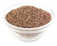 Ajwain seeds in a glass bowl. Over white background royalty free stock photography