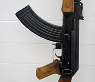 AK-47 assault rifle close up. Close up of Russian made AK-47 assault rifle with magazine, white tiled background Stock Photos