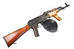 AK 47 assault rifle with round drum magazine. Isolated Stock Photos