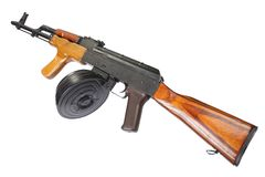 AK 47 assault rifle with round drum magazine. Isolated Stock Image