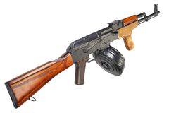 AK 47 assault rifle with round drum magazine. Isolated Royalty Free Stock Image