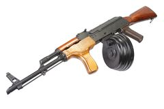 AK 47 assault rifle with round drum magazine. Isolated Royalty Free Stock Images