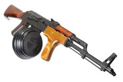 AK 47 assault rifle with round drum magazine. Isolated Royalty Free Stock Photo