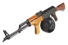 AK 47 assault rifle with round drum magazine. Isolated Royalty Free Stock Photos