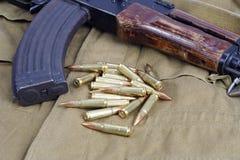 AK47 on khaki uniform. Background Royalty Free Stock Photography