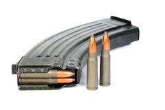 Ak-47 magazine and shells Stock Images