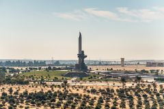 AK-47 shaped monument on the Suez Canal in Egypt. Ismailia, Egypt - November 5, 2017: AK-47 muzzle and bayonet, on the eastern shore of the Suez Canal, near royalty free stock photography