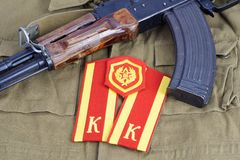AK47 with Soviet Army Cadet shoulder mark and Mechanized infantry shoulder patch on khaki uniform Royalty Free Stock Photography