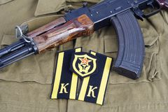 AK47 with Soviet Army Cadet shoulder mark and Soviet Army Transportation Corps shoulder patch on khaki uniform Royalty Free Stock Photo