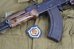 AK47 with Soviet Army Mechanized infantry shoulder patch on khaki uniform. Background Royalty Free Stock Image