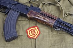 AK47 with Soviet Army Mechanized infantry shoulder patch on khaki uniform. Background Stock Photography