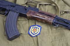 AK47 with Soviet Army Mechanized infantry shoulder patch on khaki uniform. Background Royalty Free Stock Images