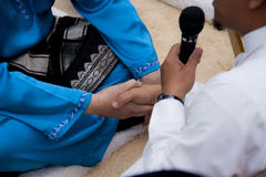 Akad Nikah (传统马来的婚礼誓约) 免版税库存照片