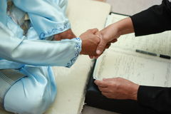 Akad nikah (marriage contract). A Malay wedding; blends indigenous marriage customs with Islamic principles. Malay weddings are grand affairs where the couple is Stock Image