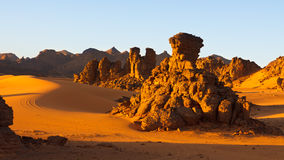 Akakus (Acacus) Mountains, Sahara, Libya. Bizarre sandstone rock formations at sunset Royalty Free Stock Photos