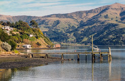 Akaroa Harbour Scenes - Robinson's Bay and Pier Stock Images