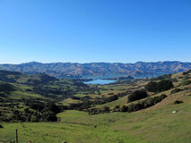 Akaroa Lookout in south New Zealand. Akaroa lookout view of sky, mount, lake, hill in south island of New Zealand Royalty Free Stock Photo