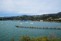 Akaroa, New Zealand. Akaroa is a small town on Banks Peninsula in the Canterbury region of the South Island of New Zealand, situated within a harbour of the same Royalty Free Stock Photo