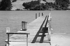 Akaroa   Old pier. Akaroa pier opier olpier oldpier sea black white royalty free stock image