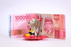 Akarta, Indonésie - 18 juin 2019 : Figures des rats et de la devise de roupie images libres de droits