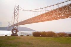 Akashi Suspension bridge over sea coast skyline. Kobe Japan Royalty Free Stock Images