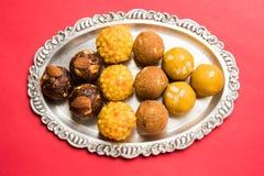 Akcyjna fotografia kolekcja rozmaitość cukierki, pomarańczowy peda, pedha lub pera robić up mleko, khoya, cukier, szafran, etc wy Zdjęcia Royalty Free