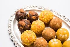 Akcyjna fotografia kolekcja rozmaitość cukierki, pomarańczowy peda, pedha lub pera robić up mleko, khoya, cukier, szafran, etc wy Obrazy Stock