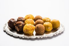 Akcyjna fotografia kolekcja rozmaitość cukierki, pomarańczowy peda, pedha lub pera robić up mleko, khoya, cukier, szafran, etc wy Zdjęcie Royalty Free