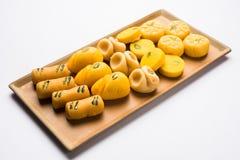 Akcyjna fotografia kolekcja rozmaitość cukierki, pomarańczowy peda, pedha lub pera robić up mleko, khoya, cukier, szafran, etc wy Obraz Stock