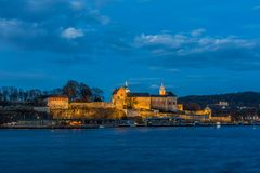 Akershus Fortress at the blue hour. View from the Aker Brygge Ma. Rina. Oslo, Norway royalty free stock image