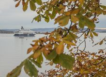 A view from the Akershus Fortress, Oslo - fjord and a ship through some yellow and green leaves. Akershus Fortress or Akershus Castle is a medieval castle that royalty free stock images