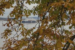 A view from the Akershus Fortress, Oslo, Norway - fjord and a ship through some yellow and green leaves. Akershus Fortress or Akershus Castle is a medieval royalty free stock photos