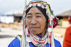 Akha Hill Tribe Lady, Myanmar. Kengtung, Myanmar - January 22, 2016. A portrait of an Akha hill tribe woman at Kengtung market in Myanmar. The Akha are an royalty free stock photos