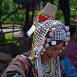 Akha hill tribe woman. Mae Salong, Northern Thailand - August 23, 2013  Akha hill tribe woman in traditional clothing Royalty Free Stock Photos