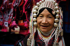 Akha smile tribe woman. CHIANG RAI, THAILAND - JANUARY 06, 2017: Unidentified Akha smile tribe woman with traiditional dress sell handmade fabric at Mae Salong stock photos