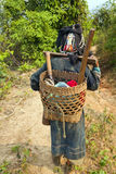 Akha villager carry things on her back in mountain, Laos Royalty Free Stock Image