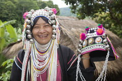 Akha woman in northern Thailand. Akha women are an ethnic group in Asia and bear rich silver jewelry Royalty Free Stock Image
