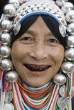 Akha woman in northern Thailand. Akha women are an ethnic group in Asia and bear rich silver jewelry Stock Image