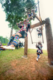 Akha woman in traditional dress playing Akha Swing Festival. CHIANG RAI,THAILAND-AUGUST 30 : The Akha hill tribe minority swing in the air as they honour their Stock Photo